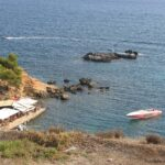Cafe at Puerto Portals Nous with speedboat Hermit moored close by