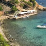 Cafe at Puerto Portals Nous Majorca with pleasure boat moored nearby