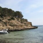 A rib boat moored at Cala Falco beach in Majorca