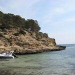 A rib boat moored at Cala Falco beach in Majorca