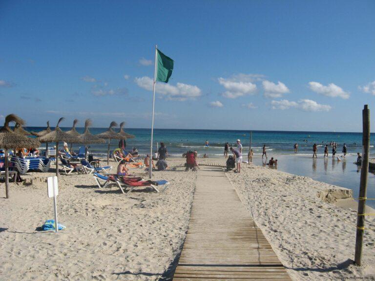 A walkway to the sea at Sa Coma beach Majorca