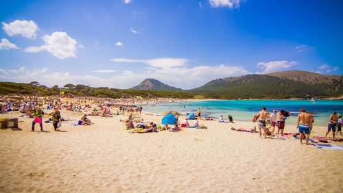 People sunbathing on Cala Ratjada beach