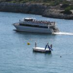 Glass bottom boat and pedalo in Porto Cristo Majorca 02