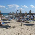 Parasols at Sa Coma beach Majorca