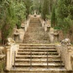 Steps with ornate carved figures at Raixa gardens Bunyola Majorca