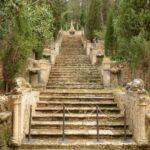 Steps with ornate carved figures at Raixa gardens Bunyola Majorca