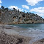 Pebble beach with steep cliffs at Cala Bota Majorca