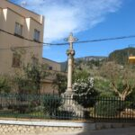 A cross monument in the centre of Bunyola Majorca