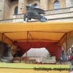 A market stall in front of the Sineu lion in Majorca