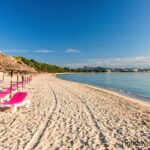 Alcudia across the beach with sun loungers and shades