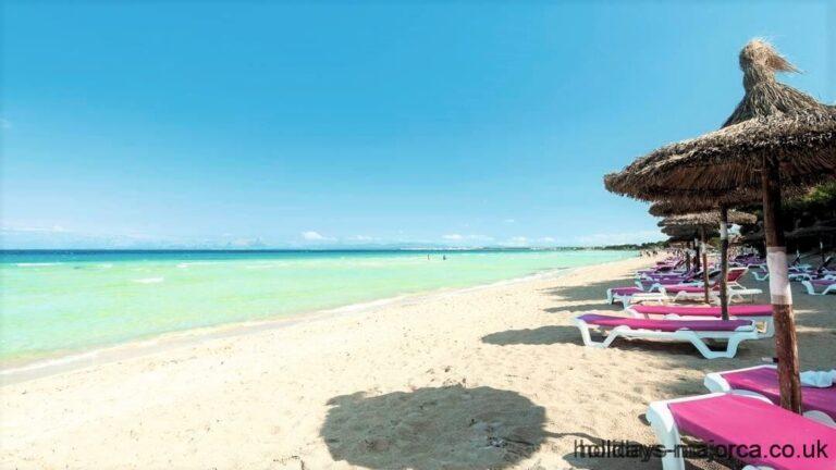 Alcudia beach with sun loungers and shades Majorca