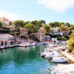 Boats in the natural harbour at Cala Figuera Majorca
