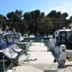 Boats on a small jetty at Santa Ponsa harbour Majorca