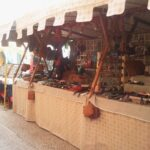 Craft stall selling bags and belts at the medieval market in Capdepera Majorca
