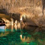 Crossing the underwater lake in the Caves of Drac Majorca