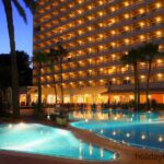 Hotel Reina lit up at night in Peguera Majorca