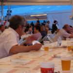 People eating and drinking at the Llampuga festival in Cala Ratjada Majorca