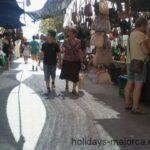 People walking amoungst the market stall in Inca Majorca