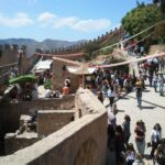 People within the Capdepera fortress wall during the medieval market Majorca