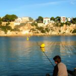 Boy shore fishing Majorca