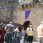 The entrace to the Capdepera hilltop fortress during the medieval market celebration Majorca