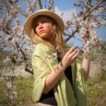 Women amongst the blossoming almond trees in Majorca